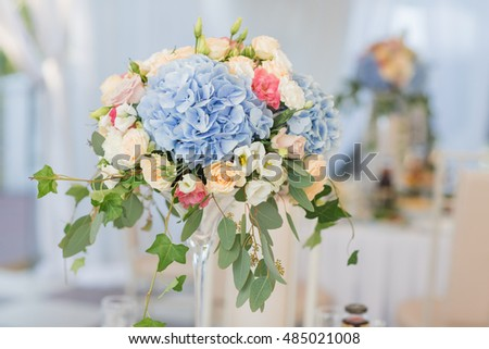 fresh floral composition on the holiday table. Beautifully organized event - served banquet tables ready for guests