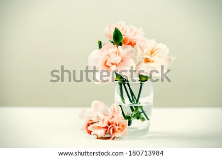 fresh flowers in a glass vase on white table