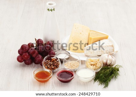 fresh food and cheese for cooking on a wooden board. Ingredients for cooking