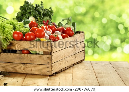 fresh food on table in wooden box  - stock photo