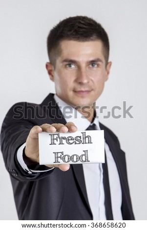 Fresh Food - Young businessman holding a white card with text - vertical image