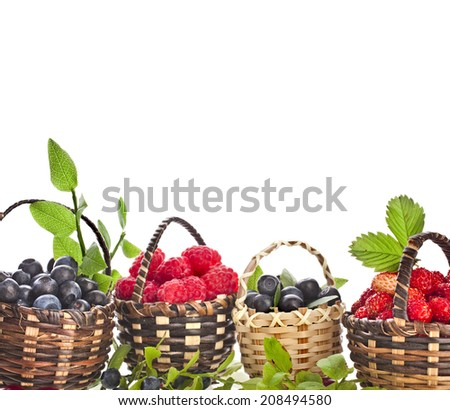 fresh forest berries : blueberries , raspberries and strawberries in the basket  isolated on white background - stock photo