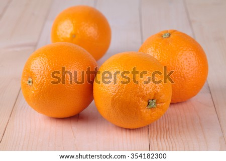Fresh four orange on wood table