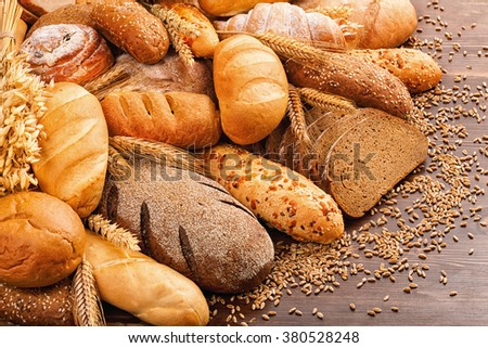 Fresh fragrant bread on the table. Food concept - stock photo