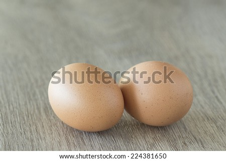 Fresh free range chicken Eggs on a wooden surface - stock photo