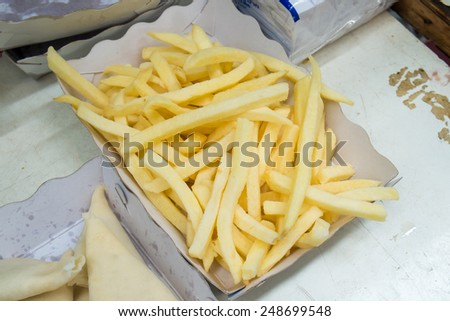 Fresh french fries in the cardboard box