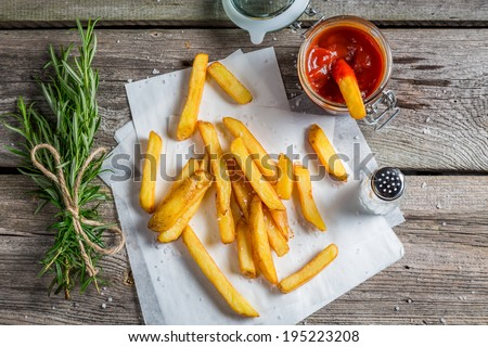 Fresh french fries served with ketchup - stock photo