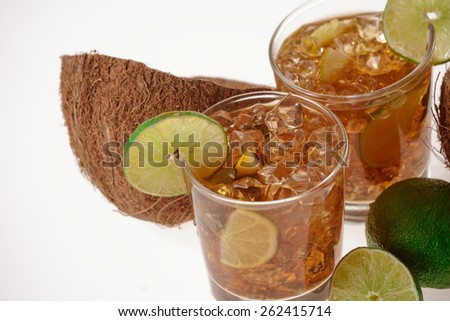 Fresh Fresh cocktail with cola drink coconut and lime fruit on white background - stock photo