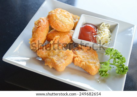 fresh fried chicken nuggets in dish - stock photo