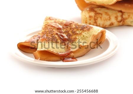 Fresh fried pancake isolate in white background - stock photo