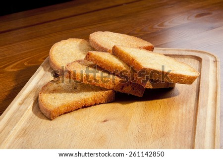Fresh fried toast on the wooden trench - stock photo