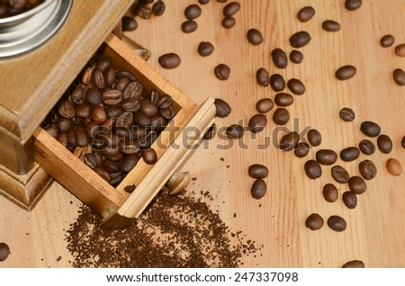 Fresh from the bag roasted Arabica and Robusta coffee bean ready for hand grinding / Coffee bean / Favorite brew for most people of the world - stock photo