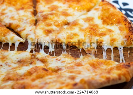 Fresh from the oven - hot and tasty pizza Margarita.. - stock photo