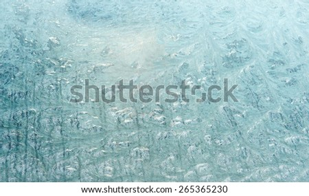 Fresh frost on the front window of old car. - stock photo
