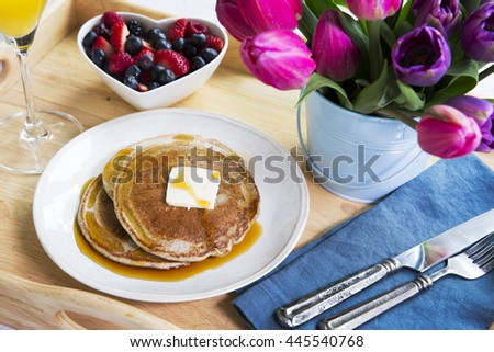 Fresh fruit and pancakes along with tulips for a wonderful brunch.