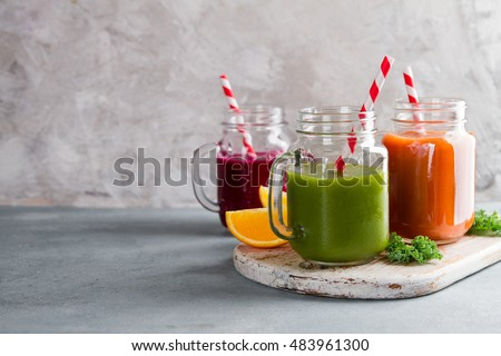 Fresh fruit and vegetable juice in the glass maison jar for detox or healthy lifestyle, selective focus