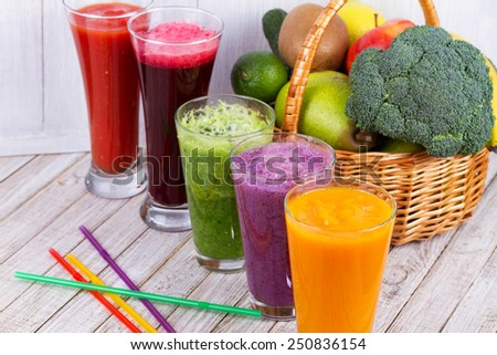 Fresh fruit and vegetable juice. Smoothie.  Close-up. Studio photography. - stock photo