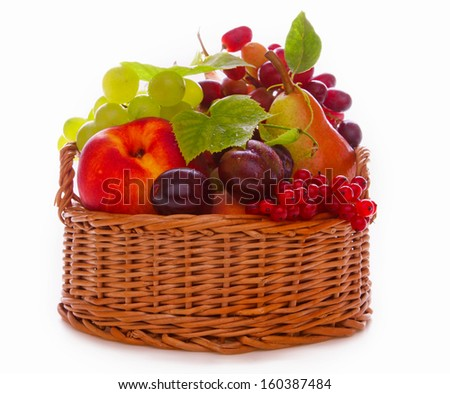 Fresh fruit basket isolated on white background. - stock photo