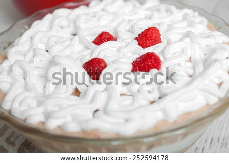 Fresh  fruit dessert with raspberries and biscuit - stock photo