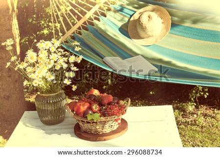fresh fruit in basket. Summertime  in the garden - stock photo