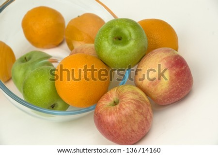 Fresh fruit in glasswares on a white background.