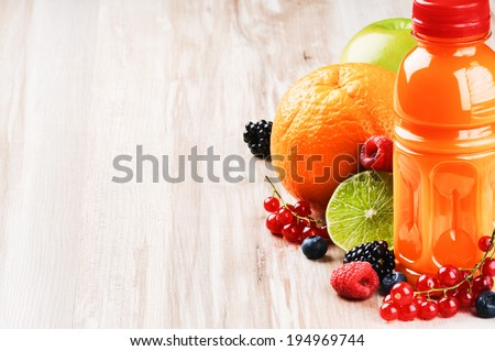 Fresh fruit juice in healthy nutrition setting  - stock photo
