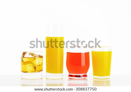 fresh fruit juices and iced drinks on white background - stock photo