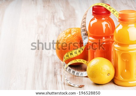 Fresh fruit juices in healthy nutrition setting  - stock photo