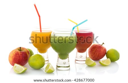 Fresh fruit juices isolated on white - stock photo