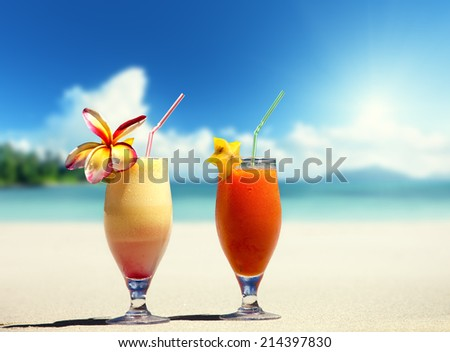 fresh fruit juices on a tropical beach - stock photo