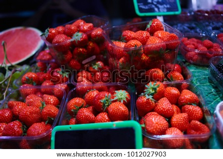 Fresh fruit on a market. Ecological berries and fruit. Antioxidants, detox diet, organic fruits. Organically grown berries and fruits for sale at the farmers' market. Healthy nutrition concept.