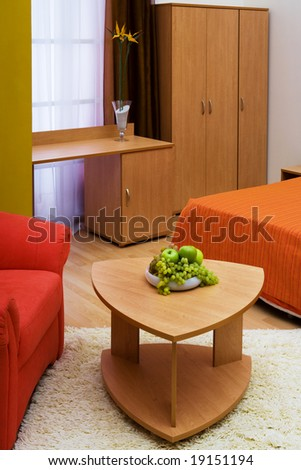 Fresh fruit on a table in a beautiful bedroom - stock photo