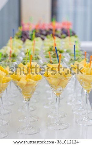 Fresh fruit salad in a glass dish. Fruit cocktails. Fresh pieces of fruit in glasses with mint on the top. Healthy life - stock photo
