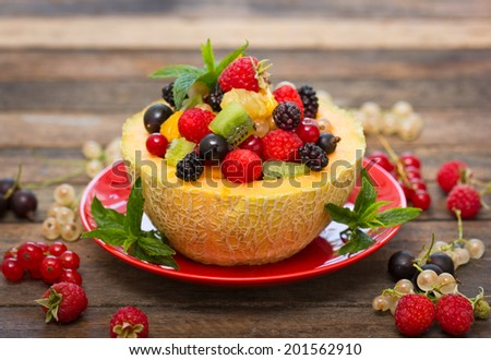 Fresh fruit salad in the melon - stock photo