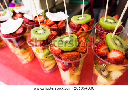 Fresh fruit salad on a market. Fruit Cocktail - stock photo