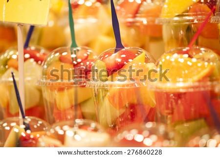 Fresh fruit salad on a market. Fruit Cocktail - stock photo