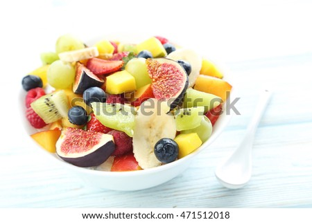 Fresh fruit salad on a white wooden table