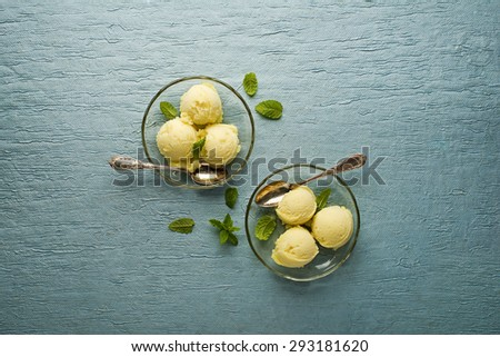 Fresh fruit sorbet ice cream in a glass plate - overhead shots. - stock photo