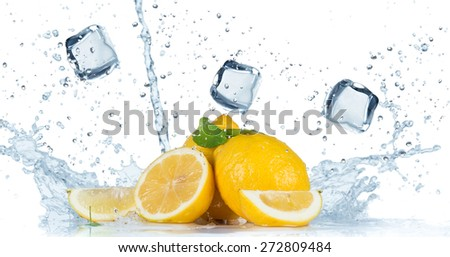 Fresh fruit with water splash over white background - stock photo