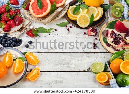 Fresh fruits and berries on a white wooden background. Healthy eating, dieting. Top view - stock photo