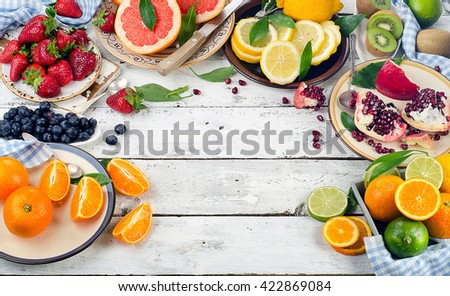 Fresh fruits and berries on white wooden background. Healthy eating, dieting. Top view - stock photo