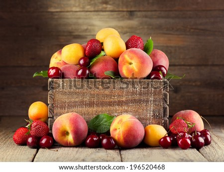 fresh fruits and berries on wooden table - stock photo