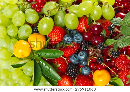 Fresh fruits and berries. Raw food ingredients. Healthy organic nutrition background - stock photo