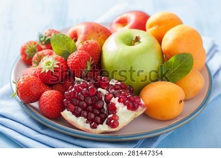 fresh fruits and berries. strawberry, apple, pomegranate - stock photo