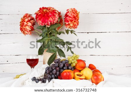 Fresh fruits and colorful flowers on a light background - stock photo