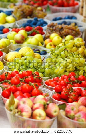 Fresh fruits and vegetables at a market stall,focus on the grapes - stock photo