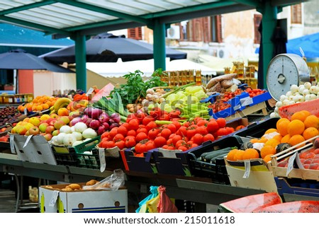 Fresh fruits and vegetables at farmers market  - stock photo
