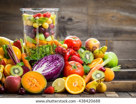 Fresh fruits and vegetables in the blender - stock photo