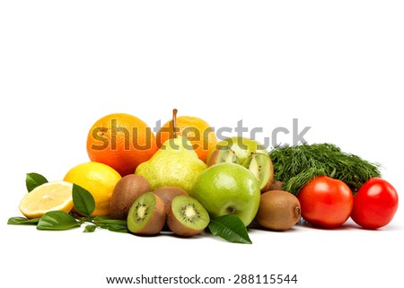 Fresh fruits and vegetables isolated on a white background.