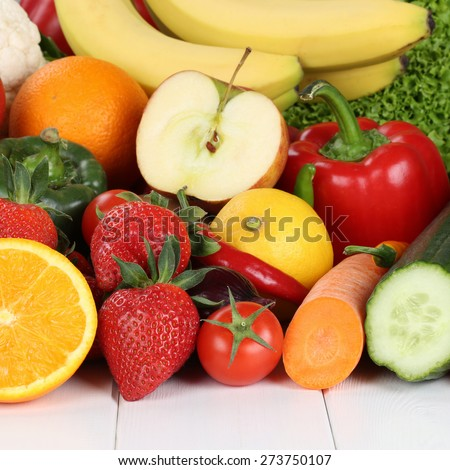 fresh fruits and vegetables like oranges, apple, tomatoes, banana, strawberry
